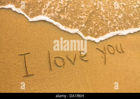 I love You - inscription on the beach sand, soft surf wave - Stock Photo