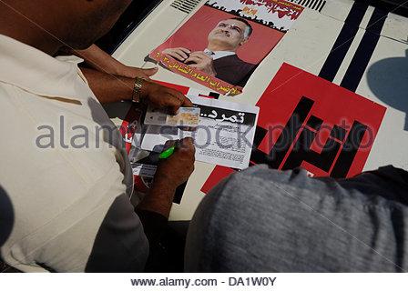 Cairo, Egypt. 30th June, 2013. Anti Muslim Brotherhood/Morsi protester in Tahrir Square signs rebel movement application - Stock Photo