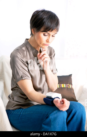 BLOOD PRESSURE, WOMAN - Stock Photo