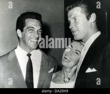FRANKIE VAUGHAN UK singer at left about 1960 with actor Roger Moore and his wife Dorothy Squires - Stock Photo