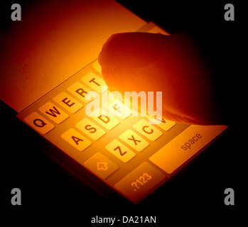 closeup finger on smart phone keyboard concept - Stock Photo