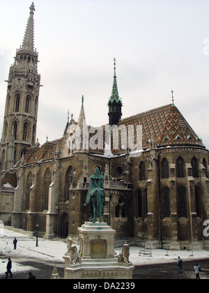Matthias Church, located in front of Statue of King Stephen at Fisherman's Bastion (Halászbástya) with snow, Budapest, - Stock Photo