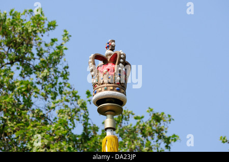 Crown on flag pole in the mall - Stock Photo