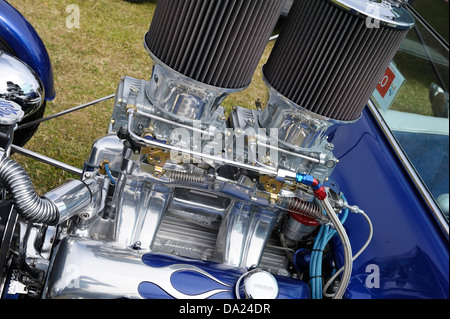 holley four barrel carburettors and air filters fitted to a custom V8 engine in a customised hot rod car - Stock Photo