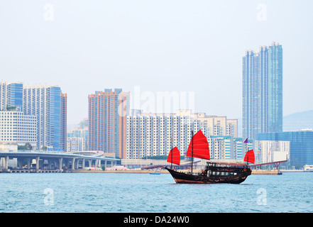 Chinese junk shp in Victoria Harbor, Hong Kong, China. - Stock Photo
