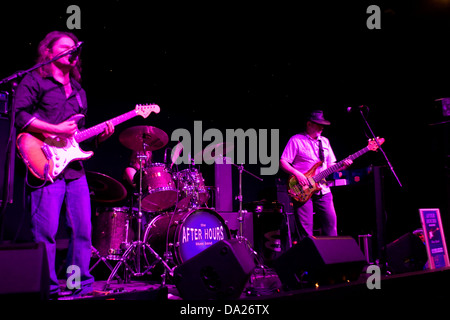 Ann Batty on Drum,Doug Long on Bass and Lee Wharton on Fender Stratocaster performing live at the Duke`s Corner - Stock Photo