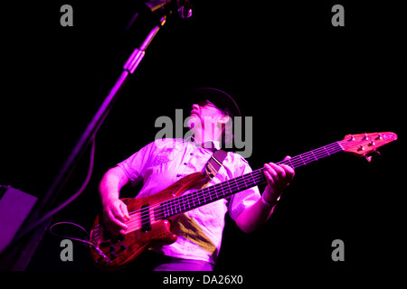 Doug Long playing the 1998 Alembic Essence 5 bass guitar during a live performance at Duke`s Corner in Dundee,UK - Stock Photo