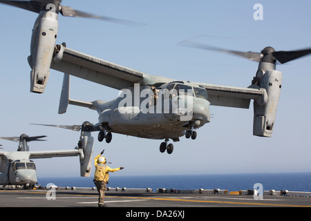 A US Marine Corps MV-22 Osprey aircraft takes off from the amphibious assault ship USS Kearsarge June 30, 2013 in the Red Sea. Stock Photo