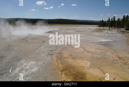 Blue sky view steaming Celestine Pool, sinter plain bacterial mat overflow, boardwalk tourists, Lower Geyser Basin, - Stock Photo