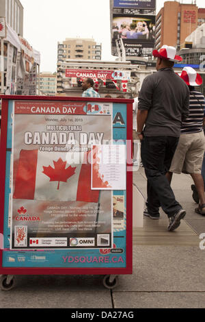 Toronto, Canada. 1st July 2013. People walking to  Yonge Dundas square  for Multicultural Canada Day Celebration - Stock Photo