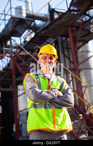 senior engineer with arms crossed in oil and chemical plant - Stock Photo