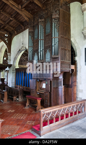 The organ in St Stephen's Church, Old Radnor, Wales. The carved wooden case dates from about 1500 and is the oldest - Stock Photo