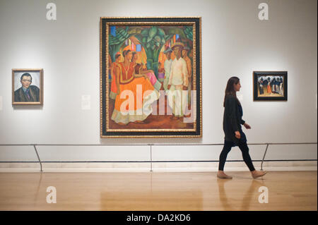 London, UK - 2 July 2013: A Royal Academy of Arts employee walks past a work by Diego Rivera entitled 'Dance in - Stock Photo