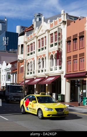 Yellow taxi/cab Chinatown, Singapore, Asia - Stock Photo