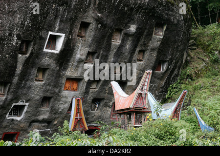 Rock with numerous tombs, Tana Toraja, Sulawesi, Indonesia - Stock Photo