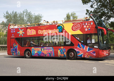 Red open top double decker sightseeing bus on Grand Parade, Bath, Somerset, England - Stock Photo