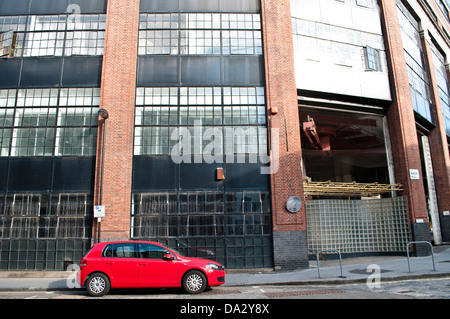 Red car and Disused building, former London College of Printing, Back Hill, Clerkenwell, London, UK - Stock Photo