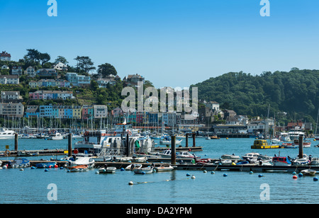 Kingswear, Devon, England. July 1st 2013. Kingswear from Dartmouth with the village and moored yachts on the River - Stock Photo