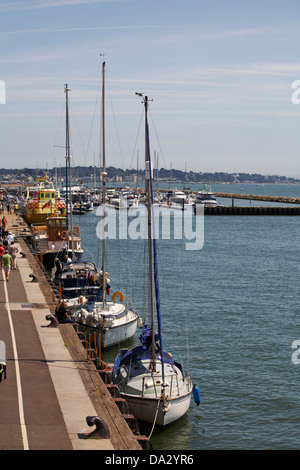 yachts and boats moored along the quayside at Poole Quay and Harbour in June - Stock Photo