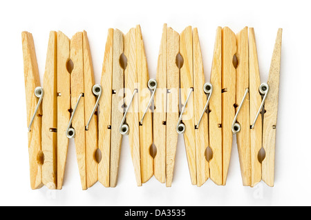 Nine wooden clothespins in row, on white background - Stock Photo
