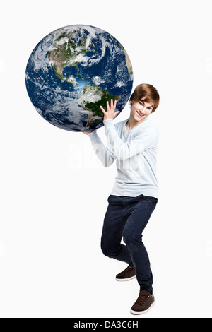 Handsome young man holding the planet earth on is hands, isolated on white - Stock Photo