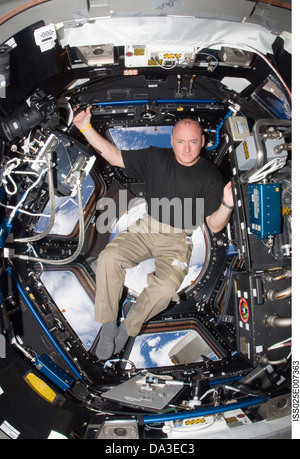 Space NASA International Space Station Astronaut Commander Scott Kelly, Expedition 25 flight engineer in the Cupola - Stock Photo