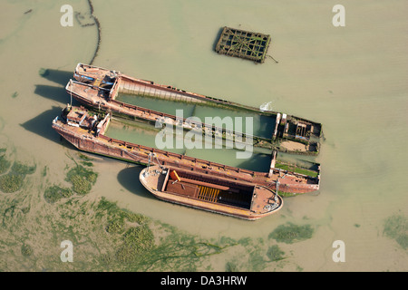 RUST IN PEACE (aerial view). Rusted boats on the Thames Estuary, Isle of Sheppey, Kent, England, Great Britain, - Stock Photo