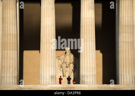 WASHINGTON DC, USA - The early morning sun shines on the statue of Abraham Lincoln in the Lincoln Memorial in Washington - Stock Photo