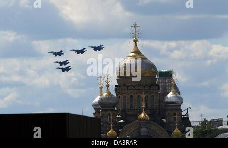 Jul 02, 2013 - St. Petersburg, Russia - Su-27 fighters of the Russkiye Vityszi 'Russian Knights' aerobatic team - Stock Photo