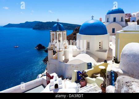 Blue domed churches on the Caldera at Oia on the Greek Island of Santorini. - Stock Photo