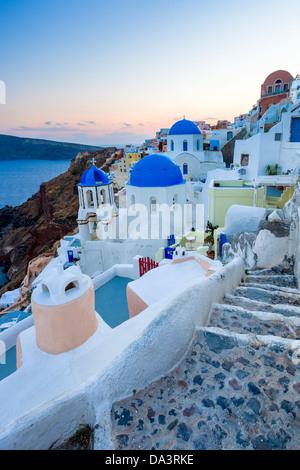 Dusk over blue domed churches at Oia Santorini Greece - Stock Photo