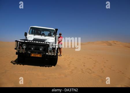 Four wheel drive on sand dunes on a Sandwich Harbour 4x4 tour, Namib-Naukluft National Park, Namibia, Africa - Stock Photo