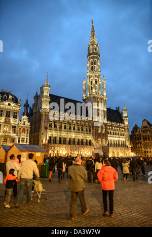 BRUSSELS, Belgium - Visitors to the Grand Place, Brussels, at night, with the Town Hall (Hotel de Ville) in the - Stock Photo