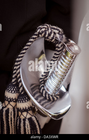 A ceremonial sword worn by military personnel on parade. - Stock Photo