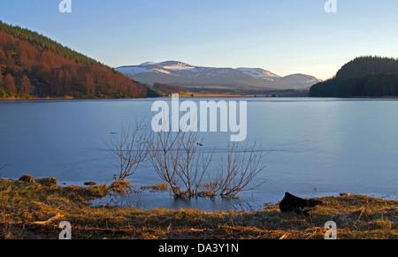 Frozen Loch Pityoulish on a winter's evening, near Aviemore, Cairngorms National Park, Scottish Highlands, Scotland - Stock Photo