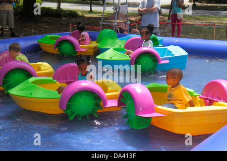 Georgia Thomasville Paradise Park Rose Show & Festival weekend Arts in the Park crafts flea market kiddie ride paddle - Stock Photo
