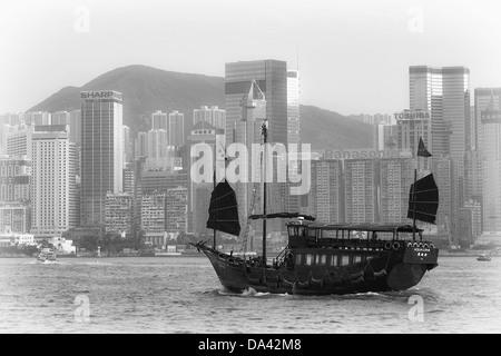 Traditional Chinese Junk Boat at Victoria Harbor in Hong Kong - Stock Photo