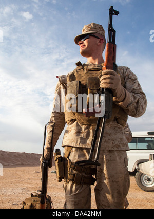U.S. Marine Corps Lance Cpl. Matthew Downing from Chicago, Ill., an ammunitions technician with Regimental Combat - Stock Photo