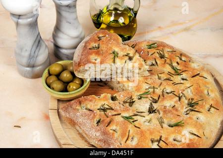 Traditional Italian rosemary Focaccia bread with green olives. - Stock Photo