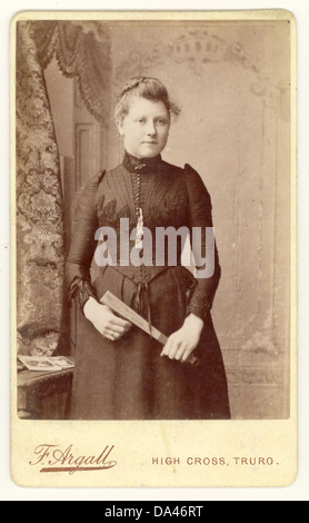 Cartes de Visite ( visiting card ) b w portrait  of a fashionable Victorian woman, wearing black and holding a fan, - Stock Photo