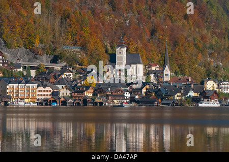 Austria, Hallstatt, Village reflection in autumn - Stock Photo