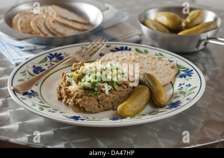 Chopped liver with matzo crackers and pickles - Stock Photo