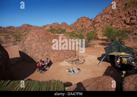 Family camping at Mowani Mountain Camp, near Twyfelfontein, Damaraland, Namibia, Africa - Stock Photo