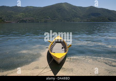 Boat on lake, Sensole, Monte Isola, Lago d'Iseo, Lombardy, Italy, May - Stock Photo