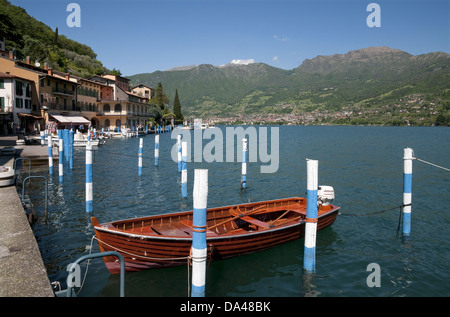 Boats in harbour of town on lake island, Peschiera Maraglio, Monte Isola, Lago d'Iseo, Lombardy, Italy, May - Stock Photo