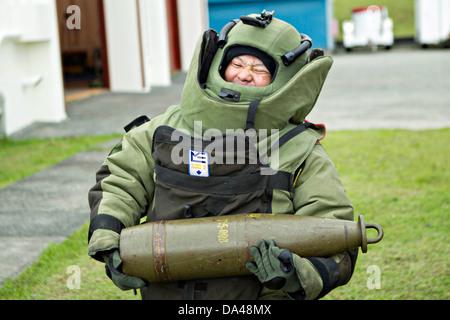 Japan Ground Self-Defense Force soldier Sgt. Maj. Arata Hamaguchi participates in simulated explosive ordnance disposal - Stock Photo