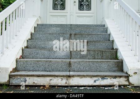 damaged stairway to door - Stock Photo
