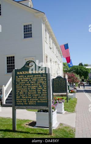 Michigan, Mackinac Island. Historic Market Street with Mackinac Island National Historic Site sign. - Stock Photo