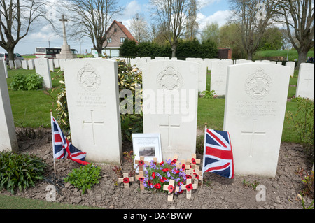 Essex Farm Commonwealth War Graves Cemetery, Ypres, Belgium. Showing grave of Rifleman Strudwick aged 15. - Stock Photo