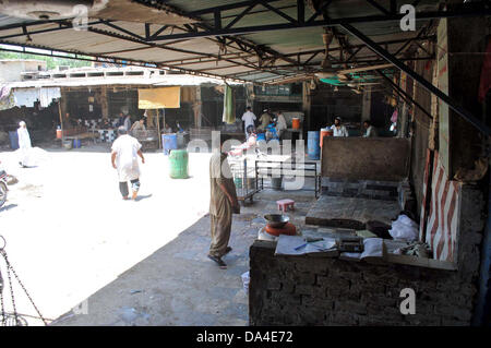 Poultry shops seen closed during strike called by poultry farms association against smuggling of chicken towards - Stock Photo